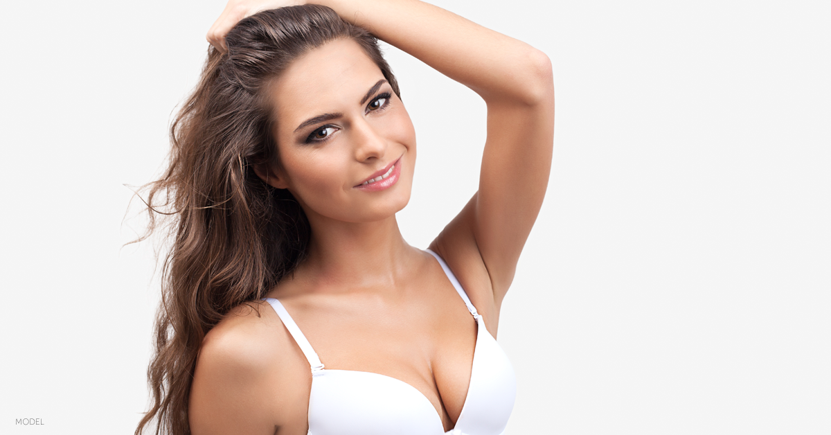 Woman in white bra desires natural looking breast augmentation